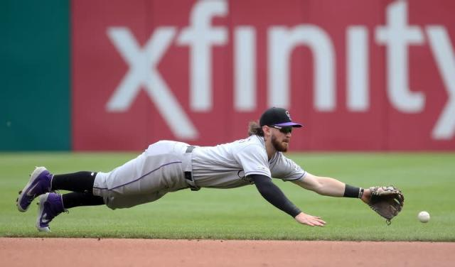 FILE PHOTO: Colorado Rockies second baseman Brendan Rodgers reaches for a ball hit for a single by Pittsburgh Pirates first baseman Josh Bell during their Major League Baseball game at PNC Park, Pennsylvania.