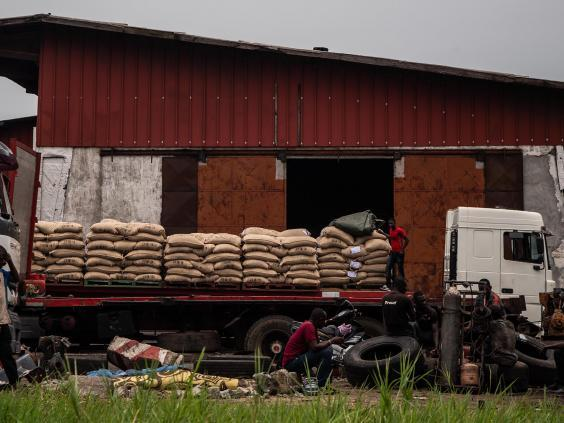 Men unload bags of cocoa near the office of Cargill, one of the leading cocoa suppliers for the chocolate industry