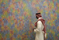 In this June 27, 2021 photo, a Saudi man looks at an artwork by Korean artist Do Ho Suh at King Abdulaziz Center for World Culture, also known as Ithra, in Dammam, Saudi Arabia. The center was built by Saudi Aramco and inaugurated by King Salman in 2016. (AP Photo/Amr Nabil)