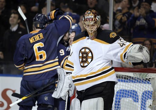 Boston Bruins goalie Tuukka Rask, of Finland, reacts after a goal by Buffalo Sabres' Jason Pominville, not seen, during the first period of an NHL hockey game in Buffalo, N.Y., Wednesday, Feb. 8, 2012. The Sabres won 6-0. (AP Photo/David Duprey)