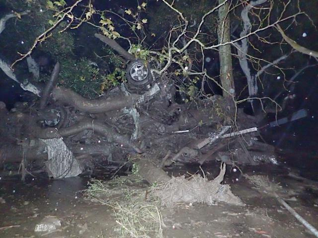 <p>An overturned car is entangled in debris after a mudslide in Montecito, Calif., Jan. 9, 2018. (Photo: Santa Barbara County Fire Department/Handout via Reuters) </p>