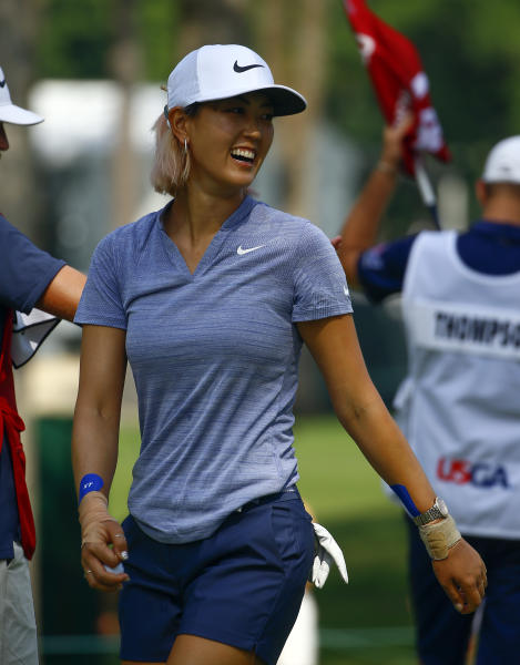 FILE - In this June 2, 2018, file photo, Michelle Wie smiles as she walks off the green after making a birdie putt on the 14th hole during the completion of the second round of the U.S. Women's Open golf tournament at Shoal Creek in Birmingham, Ala. Wie announced her engagement this week to Jonnie West, son of Lakers great Jerry West. (AP Photo/Butch Dill, File)