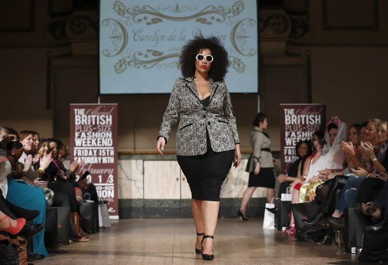 "A plus-size model wears clothes from Carolyn de la Drapiere at Shoreditch Town Hall, East London today. ""Thank you all for being who you are"", declared one of the organisers at the first Official British Plus-Size Fashion Weekend in Shoreditch, an edgy district in the east of the capital beloved of young hipsters and music fans"