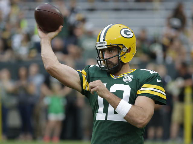 FILE - In this Aug. 16, 2018, file photo, Green Bay Packers quarterback Aaron Rodgers warms up before a preseason NFL football game against the Pittsburgh Steelers, in Green Bay, Wis. The Minnesota Vikings begin their defense of the NFC North title with a shiny new quarterback and a handful of enhancements to an already stout defense, but the rival Green Bay Packers aren't going away. And Aaron Rodgers is back, eager to make up for lost time following the broken collarbone that spoiled his 2017 season. (AP Photo/Mike Roemer, File)