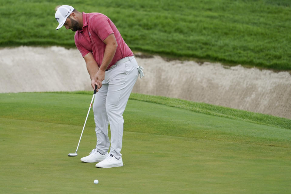 Jon Rahm, of Spain, putts on the seventh hole in the final round at The Northern Trust golf tournament at Liberty National Golf Course Monday, Aug. 23, 2021, in Jersey City, N.J. (AP Photo/John Minchillo)