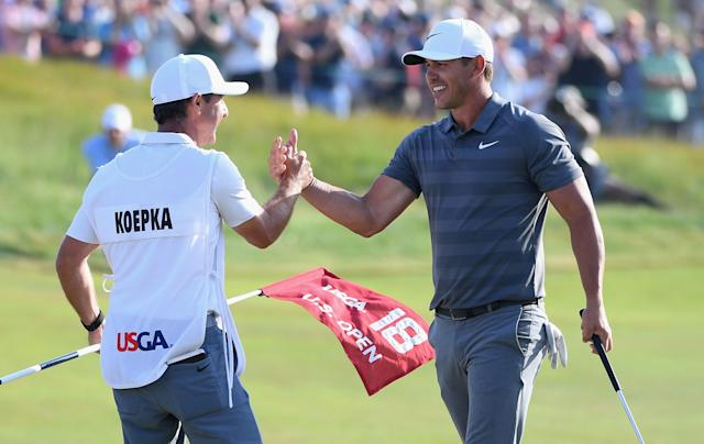 "<div class=""caption""> Brooks Koepka celebrates with caddie Richard Elliott on the 18th green at Shinnecock Hills after closing out a second-straight U.S. Open victory in 2018. </div> <cite class=""credit"">Ross Kinnaird/Getty Images</cite>"