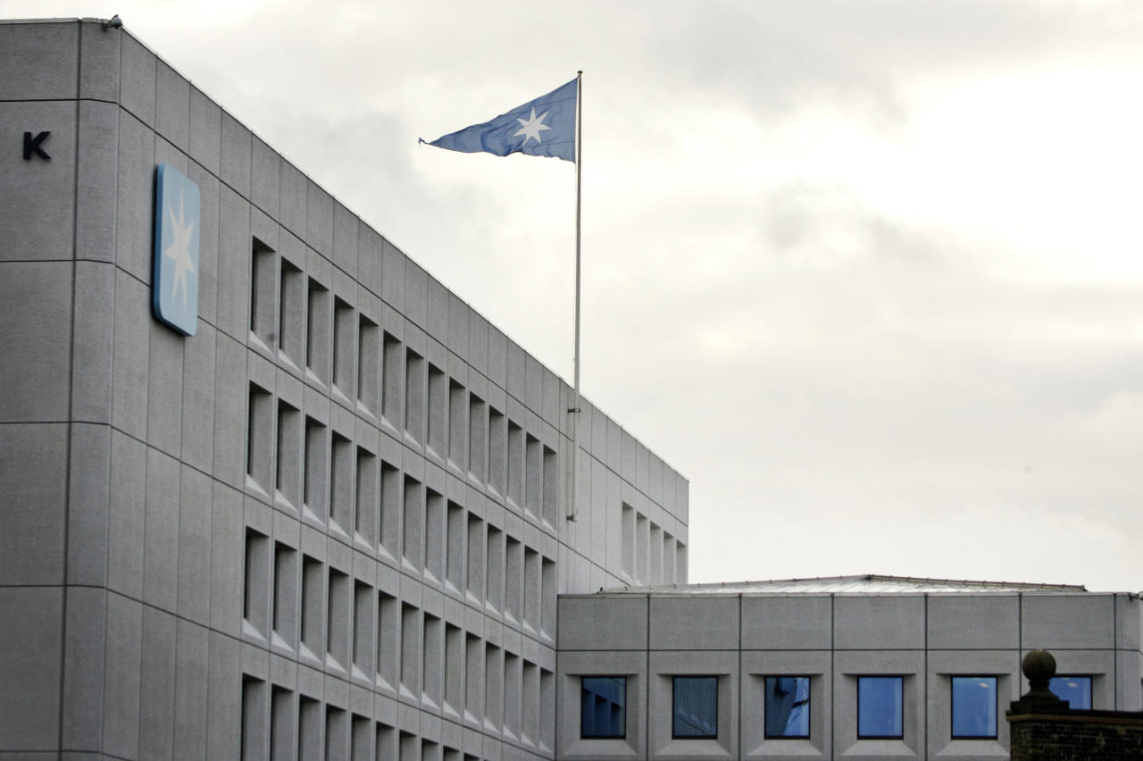 FILE - In this in this Jan. 1, 2008 file photo a flag files over the headquarters of shipping company A.P. Moller-Maersk in Copenhagen, Denmark. Hackers Tuesday June 27, 2017 caused widespread disruption across Europe, hitting Ukraine especially hard. Russia's Rosneft energy company also reported falling victim to hacking, as did shipping company A.P. Moller-Maersk, which said every branch of its business was affected. (Jens Dresling/AP via Ritzau, File) DENMARK OUT