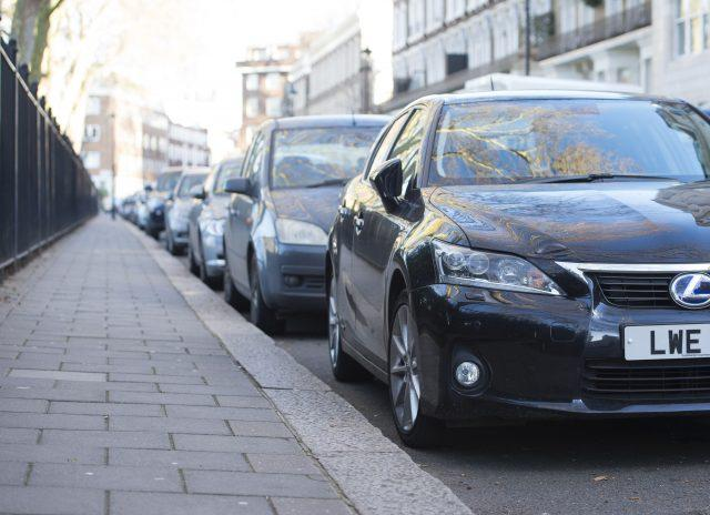 Cars parked on a residential street in London. (Lauren Hurley/PA)