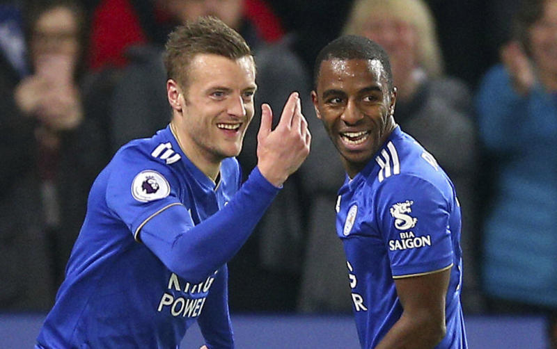 Leicester City's Jamie Vardy, left, celebrates scoring his side's second goal of the game with teammate Domingos Ricardo Pereira, during the English Premier League soccer match between Leicester and Brighton, at the King Power Stadium, in Leicester, England, Tuesday, Feb. 26, 2019. (Nigel French/PA via AP)