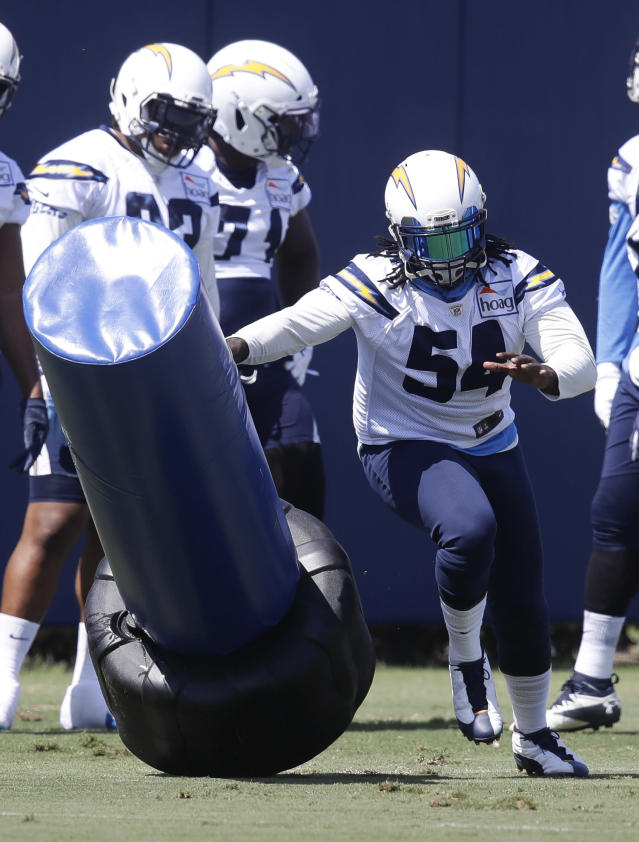 Los Angeles Chargers' Melvin Ingram works out during practice at the NFL football team's minicamp Thursday, June 14, 2018, in Costa Mesa, Calif. (AP Photo/Chris Carlson)