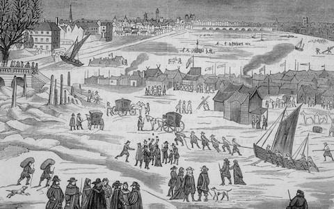 Engraving of a Frost Fair on the frozen Thames River - Credit: Getty Images Fee
