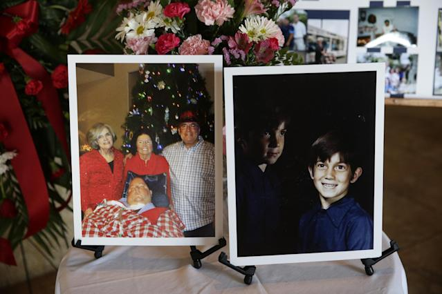 In this Friday, Jan. 10, 2014 photo, a picture of 7-year-old Mikey Cortez, right, and a recent photo of Cortez with his parents, Paul and Roonie Cortez, and grandmother Nellie are displayed at a funeral service during a funeral service for Mikey Cortez in Murietta, Calif. As his 7-year-old son Mikey lay in a hospital bed on life support, the victim of a drunk driver who had smashed into the car he was riding in, Paul Cortez took the boy's hand and made a solemn promise to God: If his son survived, no matter in what condition, he and his family would always be there for him. Although he would never emerge from the persistent vegetative state his father had found him in that night, Mikey's family was not only there for him but also gave him a full life. A life, as it turned out, not all that different from anybody else's, with cross-country family vacations and visits to Disneyland. (AP Photo/Jae C. Hong)