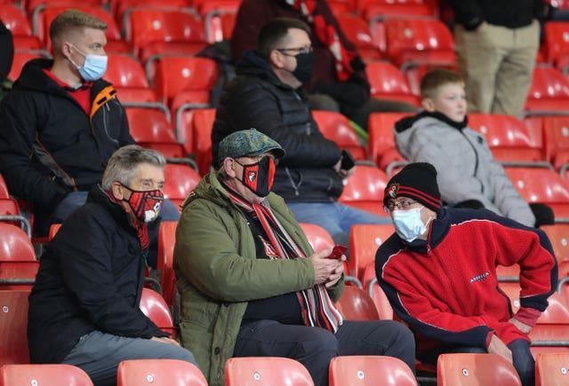 Face masks have become a common sight within football grounds since the start of the pandemic