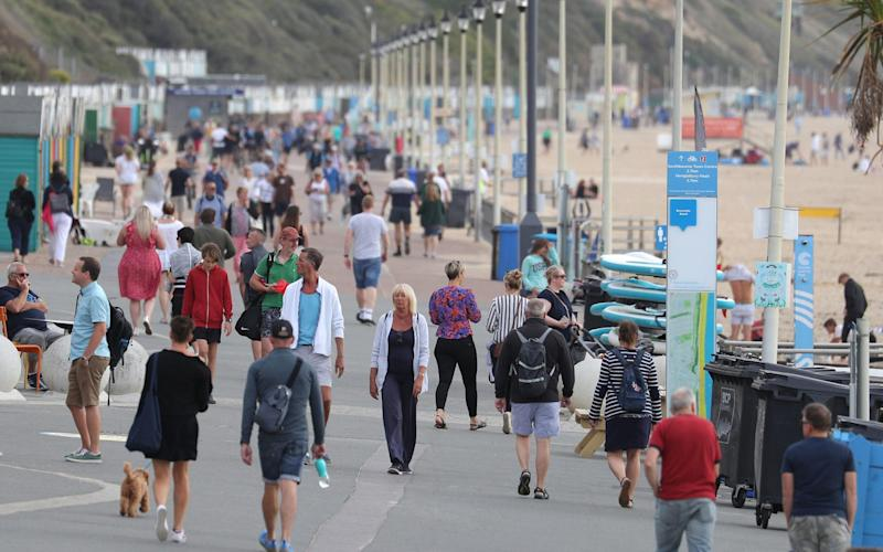 The busy beachfront at Boscombe, Dorset - Andrew Matthews/PA Wire