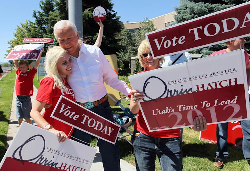 U.S. Senator Orrin Hatch, R-Utah, greets members of his family on a street corner outside his campaign headquarters, Tuesday, June 26, 2012, in Salt Lake City. The 78-year-old, six term senator is facing challenger, Utah state Senator, Dan Liljenquist in a primary election today. (AP Photo/Colin E. Braley)