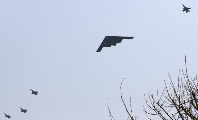 U.S. Air Force B-2 stealth bomber flies over near Osan U.S. Air Base in Pyeongtaek, south of Seoul, South Korea, Thursday, March 28, 2013. A day after shutting down a key military hotline, Pyongyang instead used indirect communications with Seoul to allow South Koreans to cross the heavily armed border and work at a factory complex that is the last major symbol of inter-Korean cooperation. (AP Photo/Shin Young-keun, Yonhap)