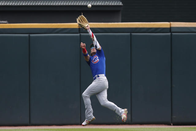 Chicago Cubs' Albert Almora Jr. leaps to make a catch on a ball hit during the first inning of a baseball game Sunday, July 7, 2019, in Chicago. (AP Photo/Jim Young)