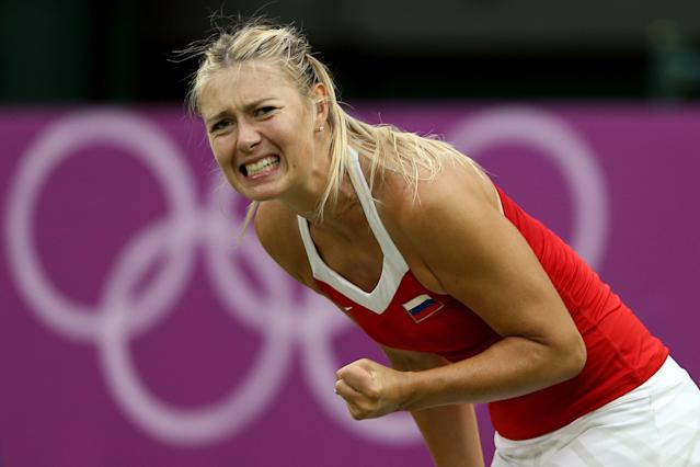 LONDON, ENGLAND - JULY 31: Maria Sharapova of Russia react after a shot against Laura Robson of Great Britain during the second round of Women's Singles Tennis on Day 4 of the London 2012 Olympic Games at Wimbledon on July 31, 2012 in London, England. (Photo by Clive Brunskill/Getty Images)