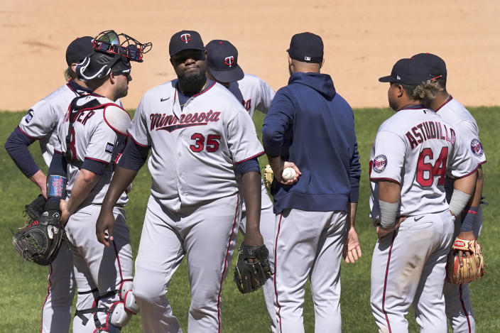 Minnesota Twins starting pitcher Michael Pineda (35) reacts after manager Rocco Baldelli relieved Pineda the sixth inning of a baseball game against the Chicago White Sox Thursday, May 13, 2021, in Chicago. (AP Photo/Charles Rex Arbogast)