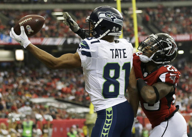 Seattle Seahawks wide receiver Golden Tate (81) makes a touch-down catch against Atlanta Falcons cornerback Robert Alford (23) during the first half of an NFL football game, Sunday, Nov. 10, 2013, in Atlanta. (AP Photo/John Bazemore)