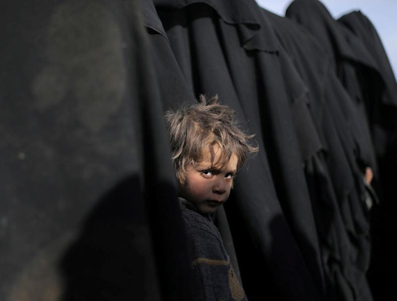 A boy looks at the camera near Baghouz, Deir Al Zor province, Syria on March 5, 2019. (Photo: Rodi Said/Reuters)