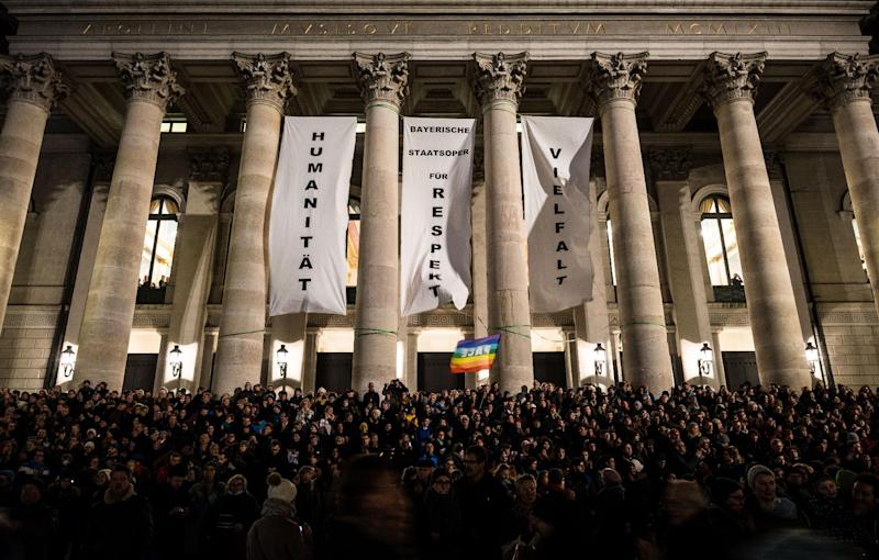 "Banners reading ""Humanity"", ""Respect"" and ""Diversity"" hang at the Opera house in Munich, southern Germany during a demonstration against the ""Patriotic Europeans Against the Islamisation of the Occident"" (PEGIDA), on December 22, 2014 (AFP Photo/Nicolas Armer)"