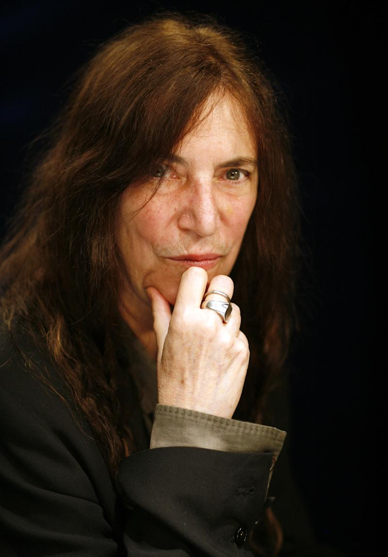 "This May 29, 2012 photo shows musician Patti Smith in New York.  Best remembered for the 1978 hit ""Because the Night,"" Smith's latest, ""Banga,"" is her first album of original music in eight years. (AP Photo/John Carucci)"