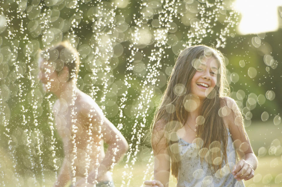 Keep kids cool and entertained this summer with a Non-Slip Splash Pad Sprinkler from Vistop. (Image via Getty Images)