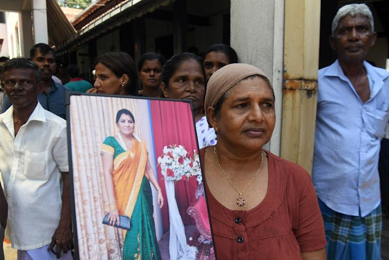 Some relatives held photographs of loved ones who they feared had died in the blasts (AFP Photo/LAKRUWAN WANNIARACHCHI)