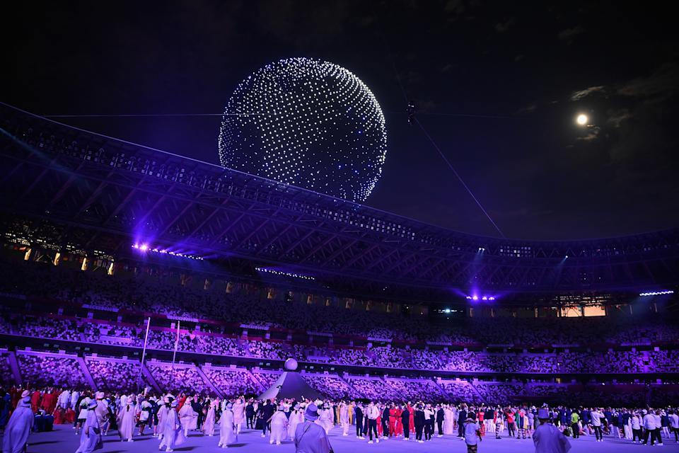 TOKYO, JAPAN - JULY 23: A drone display is seen over the top of the stadium during the Opening Ceremony of the Tokyo 2020 Olympic Games at Olympic Stadium on July 23, 2021 in Tokyo, Japan. (Photo by Matthias Hangst/Getty Images)