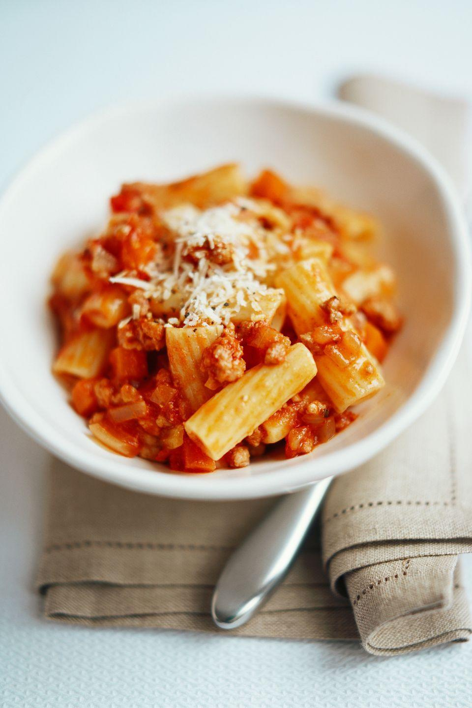 """<p>Baked rigatoni is the ultimate comfort food make-ahead meal. Try this easy freezer trick: Line a casserole dish with foil, leaving an overhang on two sides before adding the prepared pasta and freezing until just firm. Then, use the overhangs to lift the casserole out of the dish so it can stay in the freezer up to two months and simply pop back into the dish when it's time to cook. </p><p><span class=""""redactor-invisible-space""""><em><a href=""""https://www.goodhousekeeping.com/food-recipes/a15150/baked-butternut-squash-rigatoni-recipe-clv0213/"""" rel=""""nofollow noopener"""" target=""""_blank"""" data-ylk=""""slk:Get the recipe for Baked Butternut-Squash Rigatoni »"""" class=""""link rapid-noclick-resp"""">Get the recipe for Baked Butternut-Squash Rigatoni »</a></em></span></p><p><span class=""""redactor-invisible-space""""><strong>RELATED: </strong><a href=""""https://www.goodhousekeeping.com/food-recipes/easy/g1440/casserole-recipes/"""" rel=""""nofollow noopener"""" target=""""_blank"""" data-ylk=""""slk:17 Best Casserole Recipes for the Ultimate Comfort Food"""" class=""""link rapid-noclick-resp"""">17 Best Casserole Recipes for the Ultimate Comfort Food</a><strong><br></strong></span></p>"""