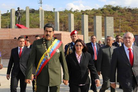 Venezuela's President Nicolas Maduro (2nd L) arrives to an event to conmemorate the bicentennial of the Battle of San Felix, next to his wife Cilia Flores (C), in San Felix, Venezuela April 11, 2017. Miraflores Palace/Handout via REUTERS