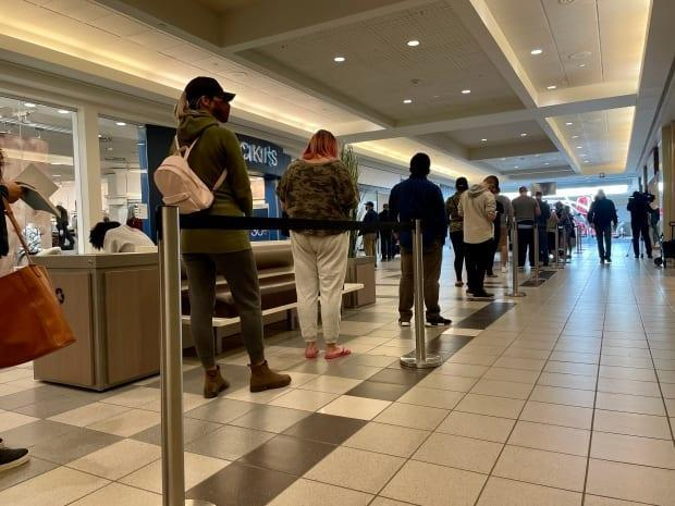 People wait in line for a COVID-19 vaccine clinic at Southland Mall in Regina, Sask., on Sept. 17, 2021.  (Jessie Anton/CBC  - image credit)