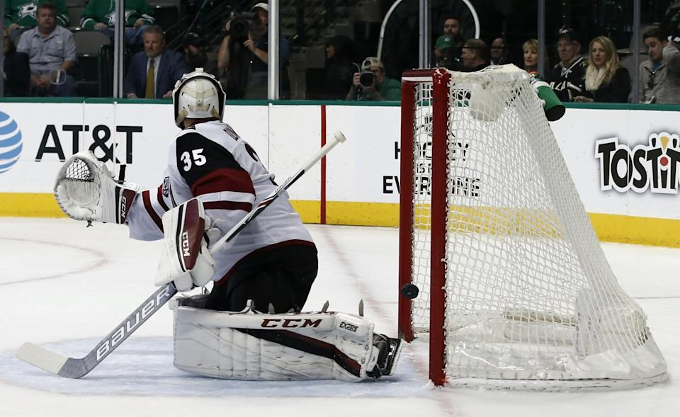 Arizona Coyotes goalie Louis Domingue is unable to stop the shot from Dallas Stars' Cody Eakin during the third period of an NHL hockey game, Friday, Feb. 24, 2017, in Dallas. (AP Photo/Mike Stone)
