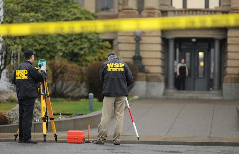 Washington State Patrol detectives investigate the scene outside the Grays Harbor County Courthouse in Montesano, Wash. Friday March 9, 2012 after an unidentified man stabbed a Superior Court judge and shot a deputy AP Photo/The Daily World, Jacob Jones).