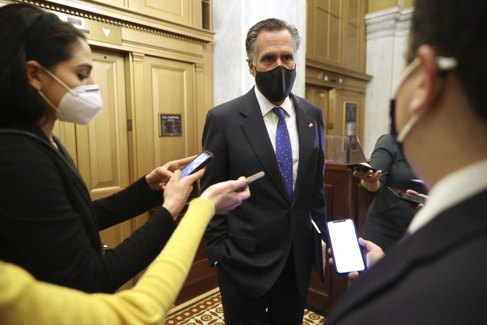 Sen. Mitt Romney, R-Utah, talks with reporters as he leaves the U.S. Capitol after the first day of Trump's second impeachment trial in the Senate, Tuesday, Feb. 9, 2021, in Washington. (Chip Somodevilla/Pool via AP)