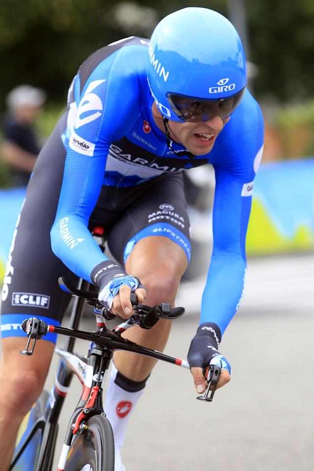"Canadian cyclist Ryder Hesjedal rides during the 21st stage of the 95th Tour of Italy ""Giro"" cycling race, a 28,2km individual time trial, on May 27, 2012 in Milan. AFP PHOTO/ LUK BENIESLUK BENIES/AFP/GettyImages"