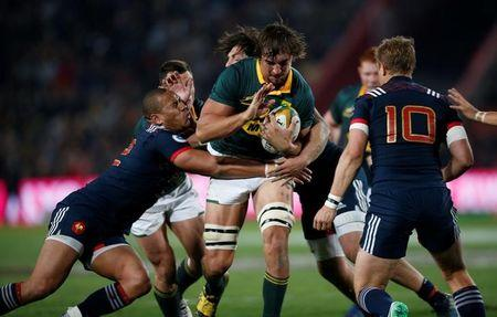 South Africa's captain Eben Etzebeth is challenged by France's Gael Fickou and Jules Plisson. South Africa v France - Ellis Park Stadium, Johannesburg, South Africa - June 24, 2017 - REUTERS/Siphiwe Sibeko