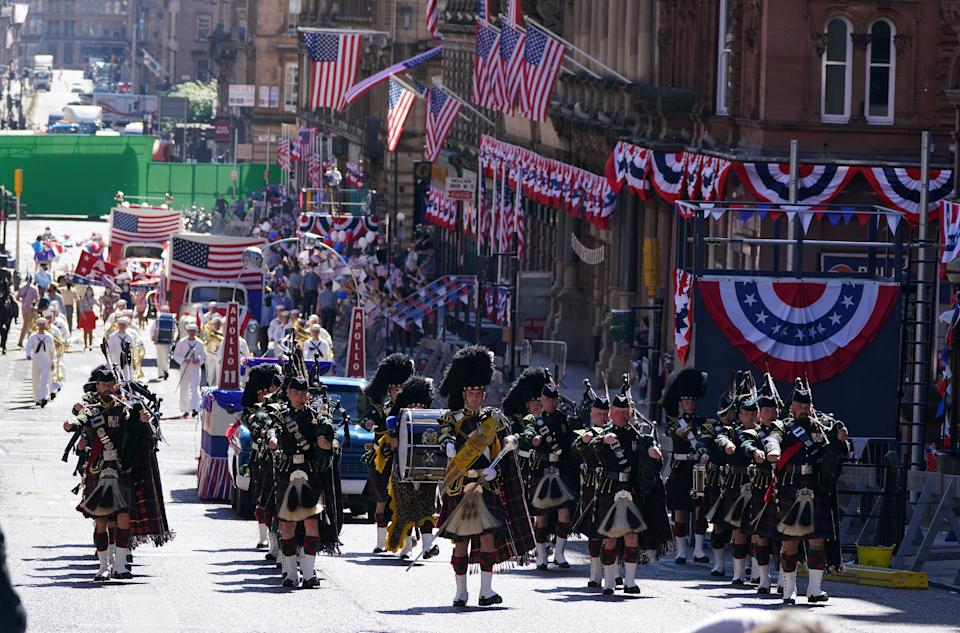 Pipers played along St Vincent Street as part of the parade (Andrew Milligan/PA) (PA Wire)