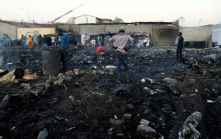 Foreigners in Marabastad, in the Pretoria area, try to save their belongings after their shacks were set alight in last month's attacks (AFP Photo/Phill Magakoe)