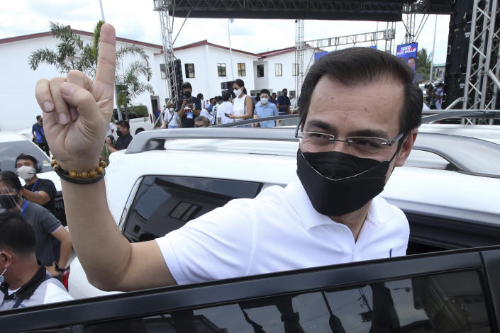 Manila Mayor Isko Moreno gestures after declaring his bid to run for president in a speech at a public school in the slum area near the place where he grew up in Manila, Philippines on Wednesday Sept. 22, 2021. The popular mayor of the Philippine capital said Wednesday he will run for president in next year's elections, the latest aspirant in what is expected to be a crowded race to succeed the controversial Rodrigo Duterte. (AP Photo)