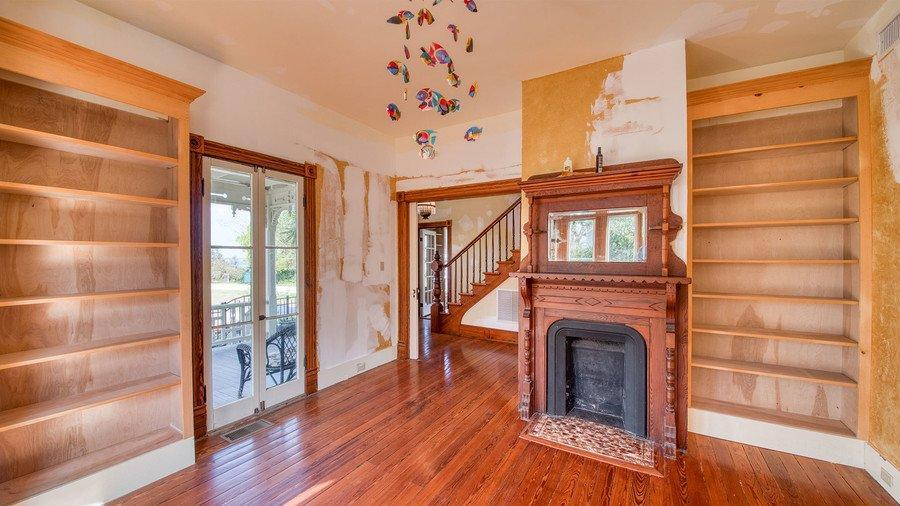 """Behold: the rare opportunity to own a piece of Hollywood history tucked away in one of the most beautiful corners of the South. Nineties kids and their parents will likely recognize the 131-year-old Captain's House in Old Town Fernandina Beach, Florida, as Villa Villekulla, the fictional home of Pippi Longstocking in the 1987 movie The New Adventures of Pippi Longstocking. Today, we can see why the one-of-a-kind residence is one of Fernandina Beach's most photographed homes. And it's currently on the market for $750,000. This 2,220-square-foot home has so much more to offer than its claim to fame as the on-screen residence of everyone's favorite """"freckle-faced redhaired girl."""" Sure, it needs a little work, but its quirky architecture, original details, and magnificent views of the Amelia River are worth a little elbow grease. And even don't get us started on all the stained glass!"""