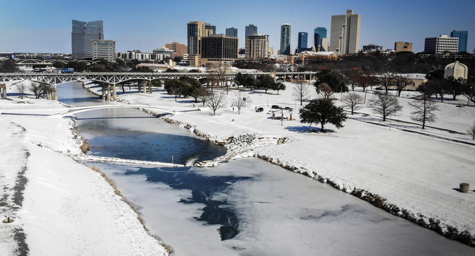 The Trinity River is mostly frozen after a snow storm Monday, Sept. 15, 2021, in Fort Worth, Texas. A frigid blast of winter weather across the U.S.  has left more than 2 million people in Texas without power. (Yffy Yossifor/Star-Telegram via AP)