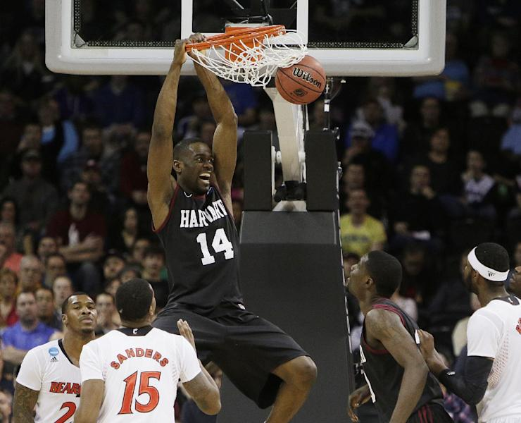 Harvard's Steve Moundou-Missi (14) dunks against Cincinnati in the second half during the second-round of the NCAA men's college basketball tournament in Spokane, Wash., Thursday, March 20, 2014. (AP Photo/Young Kwak)