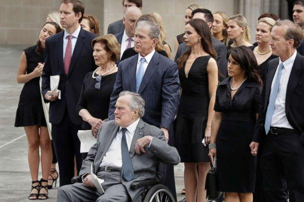 PHOTO: Former Presidents George H.W. Bush and George W. Bush accompanied by family members watch as pallbearers carry the casket of former first lady Barbara Bush following a funeral service at St. Martin's Episcopal Church, April 21, 2018, in Houston. (Evan Vucci/AP)