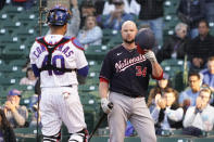 Washington Nationals' Jon Lester (34) tips his helmet as he comes to bat as Chicago Cubs catcher Willson Contreras (40) stands nearby during the second inning of a baseball game, Monday, May, 17, 2021, in Chicago. (AP Photo/David Banks)