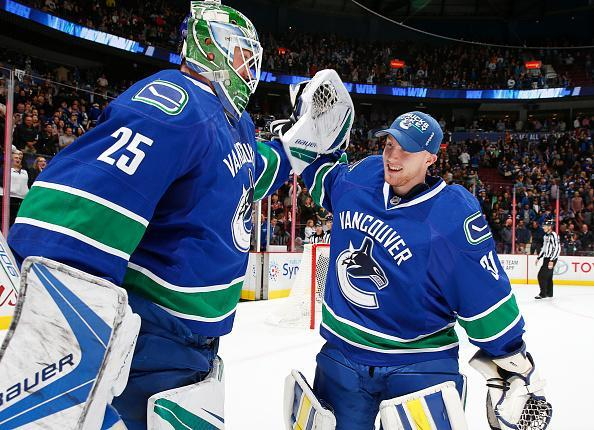 VANCOUVER, BC - OCTOBER 18: Matt Hewitt #31 of the Vancouver Canucks congratulates winning goaltender Jacob Markstrom #25 after defeating the St. Louis Blues in their NHL game at Rogers Arena October 18, 2016 in Vancouver, British Columbia, Canada. Vancouver won 2-1 in overtime. (Photo by Jeff Vinnick/NHLI via Getty Images)