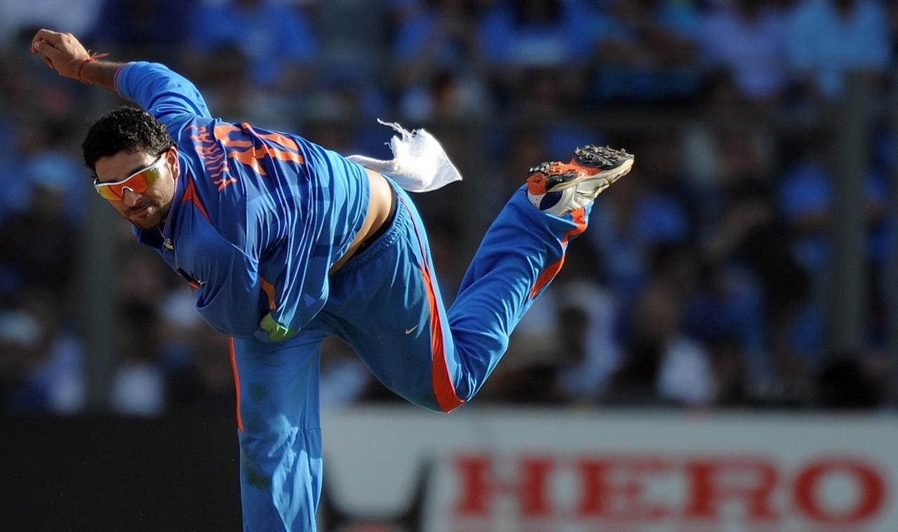 Indian cricketer Yuvraj Singh delivers a ball during The ICC Cricket World Cup 2011 final between India and Sri Lanka at The Wankhede Stadium in Mumbai on April 2, 2011.   AFP PHOTO/MANAN VATSYAYANA (Photo credit should read MANAN VATSYAYANA/AFP/Getty Images)