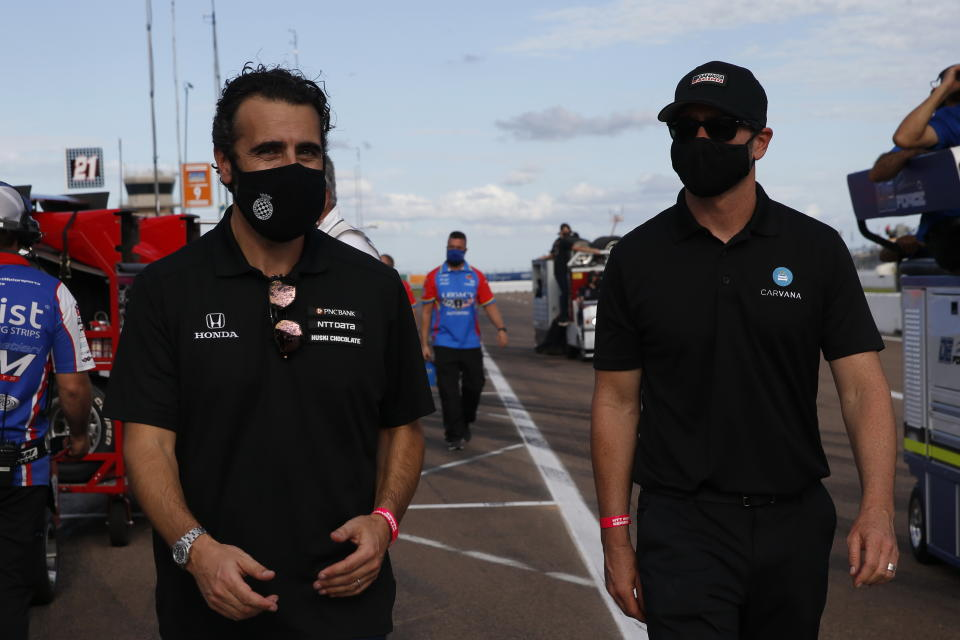 <em>Jimmie Johnson walks through the pits Saturday with Chip Ganassi Racing consultant and four-time IndyCar champion Dario Franchitti (Chris Jones/IndyCar).</em>