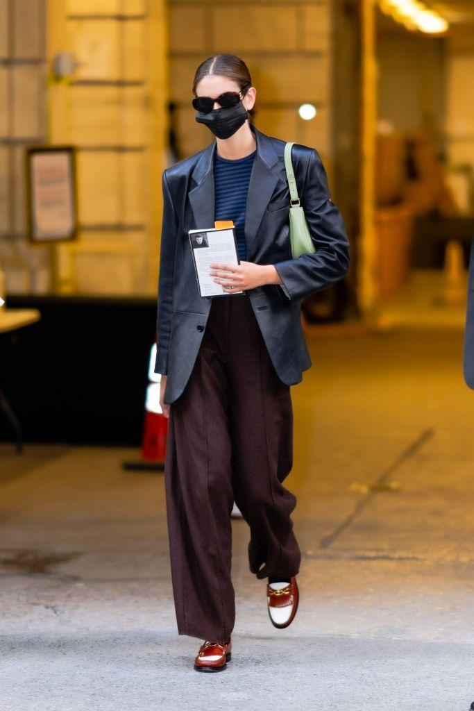 """<p>The supermodel made a rare appearance leaving Marc Jacob's AW21 show in New York wearing a Celine Ava bag in pistachio, a leather blazer, blue Breton t-shirt, maroon wide-leg trousers and two-tone loafers, plus, a copy of Raymond Carver's What We Talk About When We Talk About Love. </p><p><a class=""""link rapid-noclick-resp"""" href=""""https://www.celine.com/en-gb/celine-shop-women/handbags/ava/ava-bag-in-smooth-calfskin-193953DGQ.31SA.html"""" rel=""""nofollow noopener"""" target=""""_blank"""" data-ylk=""""slk:SHOP KAIA'S BAG NOW"""">SHOP KAIA'S BAG NOW</a></p>"""